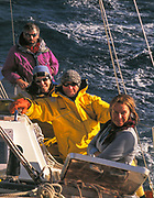Kiwi yachtie & mountaineer Greg Landreth (at rear), Tim & Pauline Carr  (centre) & Greg's wife and co-skipper Canadian Kerri Pashuk sailing Northanger down Beagle Channel on way back after winter/spring ski expedition to Chilean peaks in Tierra del Fuego.