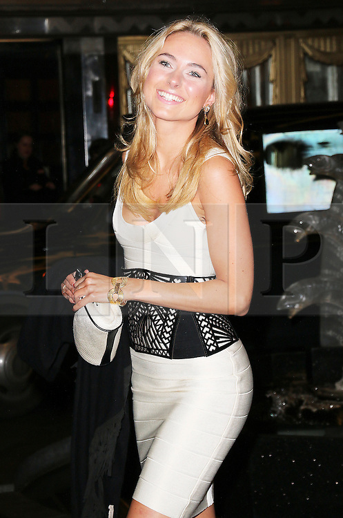 © London News Pictures. Kimberley Garner attends the Exhibition of exclusive photographs of Kate Moss at The Savoy, London UK, 30 January 2014, Photo credit: Richard Goldschmidt/LNP