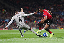 BSC Young Boys' Mohamed Ali Camara (left) and Manchester United's Anthony Martial battle for the ball during the UEFA Champions League, Group H match at Old Trafford, Manchester. PRESS ASSOCIATION Photo. Picture date: Tuesday November 27, 2018. See PA story SOCCER Man Utd. Photo credit should read: Martin Rickett/PA Wire.
