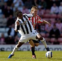 Photo: Jed Wee.<br />Sunderland v Newcastle United. The Barclays Premiership. 17/04/2006.<br /><br />Newcastle's Celestine Babayaro (L) edges out Sunderland's Liam Lawrence for possession.