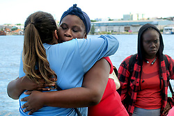 Akela Moxey, who was evacuated from Freeport, Bahamas, aboard Royal Caribbean's Mariner of the Seas cruise ship, hugs a Royal Caribbean employee (left) goodbye after arriving in Nassau on Saturday, Sept. 7, 2019. Freeport sustained devastating damage because of Hurricane Dorian. Photo by Joe Burbank/Orlando Sentinel/TNS/ABACAPRESS.COM