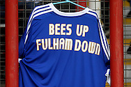 A Brentford shirt showing a message to the Fulham fans pre kick off. Skybet football league championship match, Brentford  v Fulham at Griffin Park in London on Saturday 30th April 2016.<br /> pic by Steffan Bowen, Andrew Orchard sports photography.