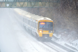 © Licensed to London News Pictures.01/03/2018<br /> Pettswood, UK.<br /> Train heading for Orpington.<br /> Commuters make a brave effort to get to work in London from Pettswood Train Station in Kent as Storm Emma brings more snow and winds this morning.<br /> Photo credit: Grant Falvey/LNP