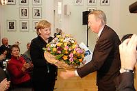 08 NOV 2006, BERLIN/GERMANY:<br /> Angela Merkel (L), CDU, Bundeskanzlerin, bekommt Blumen von Arend Oetker (R), Praesident der Deutschen Gesellschaft für Auswärtige Politik, nach einer europapolitischen Grundsatzrede vor dem Alfred von Oppenheim-Zentrum fuer Europaeische Zukunftsfragen der Deutschen Gesellschaft fuer Auswaertige Politik, DGAP<br /> IMAGE: 20061108-02-015