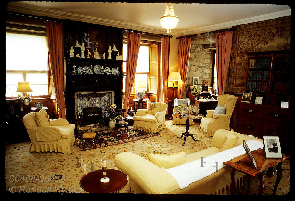Queen Mother's Sitting Room in Royal Apartments features family portraits and memorabilia; Glamis Castle, Scotland.
