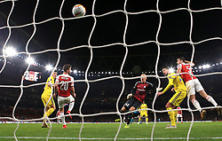 Arsenal's Sokratis Papastathopoulos (right) scores his side's third goal of the game during the UEFA Europa League round of 32 second leg match at the Emirates Stadium, London.