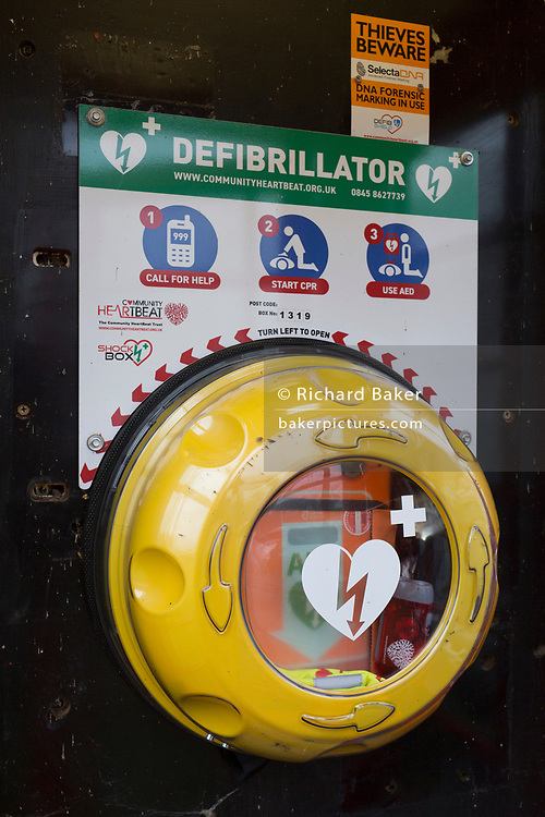 A defibrillator located inside an old phone box, to be used by the public in emergencies, placed opposite the Bucks Head pub in Godden Green, 5th January 2019, in Kent, England.