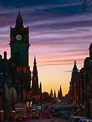 Edinburgh, Scotland, UK. 24 December 2020. Beautiful Christmas Eve and Brexit Deal sunset over Edinburgh viewed along Princes Street. Iain Masterton/Alamy Live News.