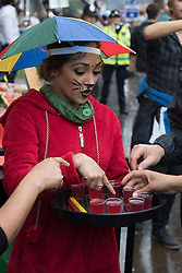 London, August 31st 2015. XXXX as revellers ignore the inclement weather to enjoy day two of the Notting Hill Carnival.