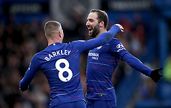 Chelsea's Gonzalo Higuain (right) celebrates scoring his side's fourth goal of the game with team mate Ross Barkley during the Premier League match at Stamford Bridge, London.