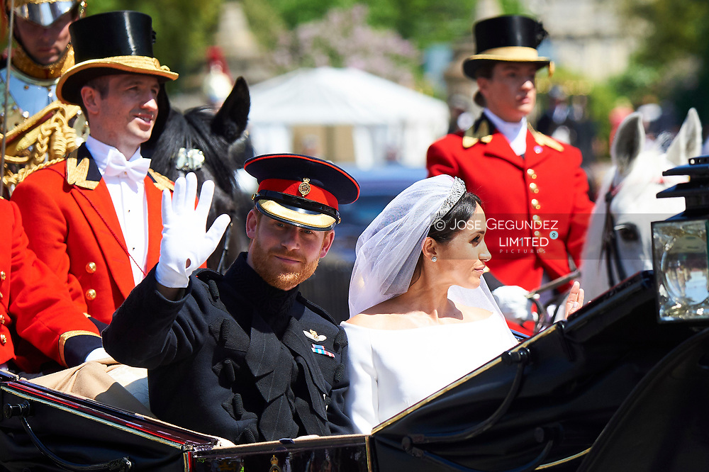 Prince Harry, Duke of Sussex, Meghan Markle, Duchess of Sussex during Carriage Procession after the Royal Wedding of Prince Harry and Meghan Markle at Windsor Castle on May 19, 2018 in Windsor, Berkshire, United Kingdom