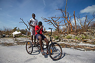 Juvence Davlmay, 11, left, and cousin Rodney Dorvilus,14, look at the destruction from Hurricane Dorian at Marsh Harbour in Great Abaco Island, Bahamas on Wednesday, September 4, 2019