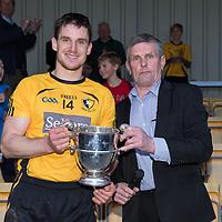 Clonlara Captain John Conlon receiving the trophy from County Board Chairman Joe Cooney