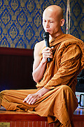 24 OCTOBER 2010 - CHANDLER, AZ: Ajahn MAHA AMPORN leads prayers during the Ok Phansa services to mark the end of Buddhist Lent at Wat Pa, in Chandler, AZ, Sunday October 24. Buddhist Lent is a time devoted to study and meditation. Buddhist monks remain within the temple grounds and do not venture out for a period of three months starting from the first day of the waning moon of the eighth lunar month (in July) to the fifteenth day of the waxing moon of the eleventh lunar month (in October). Ok Phansa Day marks the end of the Buddhist lent and falls on the full moon of the eleventh lunar month, this year Oct 23. Wat Pa, a Thai Theravada Buddhist temple, celebrated Ok Phansa Day on October 24.    Photo by Jack Kurtz