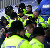 Photo. Glyn Thomas.<br />Mansfield Town v Hull City.<br />Nationwide League Division 3.<br />Field Mill, Mansfield. 06/03/2004.<br />Police remove troublesome Mansfield fans from the ground.