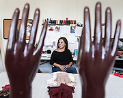 Damari Rubio poses for a portrait in her studio Tuesday June 2, 2015. Rubio, who designs gloves under the name Damari has been doing so for a year. (Michael Starghill, Jr.)