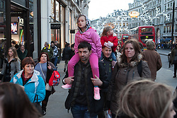 Christmas Shoppers in London's Oxford Street. London, United Kingdom. Friday, 20th December 2013. Picture by Daniel Leal-Olivas / i-Images