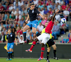 26.05.2012, Ullevaal Stadion, Oslo, NOR, UEFA EURO 2012, Testspiel, Norwegen vs England, im Bild England's Andy Carroll (Liverpool) in action against Norway's Alexander Tettey (Rennes) during the Preparation Game for the UEFA Euro 2012 betweeen Norway and England at the Ullevaal Stadium, Oslo, Norway on 2012/05/26. EXPA Pictures © 2012, PhotoCredit: EXPA/ Propagandaphoto/ Vegard Grott..***** ATTENTION - OUT OF ENG, GBR, UK *****