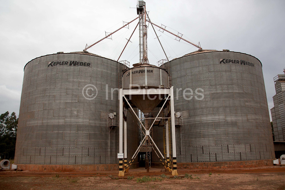 Silos for grain storage on a large soya and maize farm. Brazil is the largest producer of Sugar and Beef, then second for Soya and third for Maize. Many of the farms are in the state of Mato Grosso and Mato Grosso do Sul, they are often enournmous, stretching for miles kilometres. A lot of the crops are processed on site and kept in large warehouses or silos.