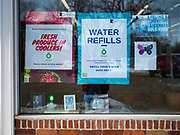 "25 FEBRUARY 2020 - BUTTERFIELD, MINNESOTA: Advertisements in the window at the True Value Hardware Store in Butterfield, MN, a farming community of about 500 people 130 miles southwest of the Twin Cities. The town has been a ""food desert"" for 10 years after its only grocery store closed in 2010. Barb Mathistad Warner and Mark Warner purchased the True Value store in Butterfield in December, 2018 and started selling groceries in the store in May, 2019. For residents of Butterfield going to a grocery store meant driving 10 miles to St. James, MN, or 20 miles to Windom, MN, the two nearest communities with grocery stores. The USDA defines rural food deserts as having at least 500 people in a census tract living 10 miles from a large grocery store or supermarket. There is a convenience store in Butterfield, but it sells mostly heavily processed, unhealthy snack foods that are high in fat, sugar, and salt.    PHOTO BY JACK KURTZ"