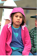 Tired spectator age 8 at Cinco de Mayo festival.  St Paul Minnesota USA
