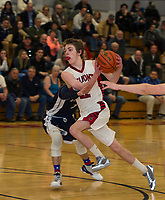 Derek Stevens of Belmont charges down court past Jake Proulx from St. Thomas Aquinas during NHIAA Division III second round tournament play Thursday evening.  (Karen Bobotas/for the Laconia Daily Sun)