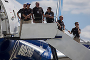 Boeing employees line the steps of their 787 jet airliner, being exhibited at the Farnborough Air Show, England. Boeing employee (as of June 2014) 169,251.