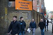 Please use the toilets provided sign on Brick Lane, London, UK.