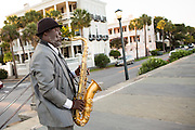 A street musician plays the saxophone along the high battery in the historic district August 11, 2013 in Charleston, SC.