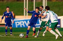 Jure Matjasic of Drava vs Zeljko Filipovic of Olimpija  at 18th Round of PrvaLiga football match between NK Olimpija and NK Labod Drava, on November 21, 2009, in ZAK, Ljubljana, Slovenia. Olimpija defeated Drava 3:0. (Photo by Vid Ponikvar / Sportida)