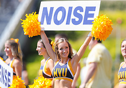 Sep 18, 2021; Morgantown, West Virginia, USA; A West Virginia Mountaineers cheerleader performs during the second quarter against the Virginia Tech Hokies at Mountaineer Field at Milan Puskar Stadium. Mandatory Credit: Ben Queen-USA TODAY Sports