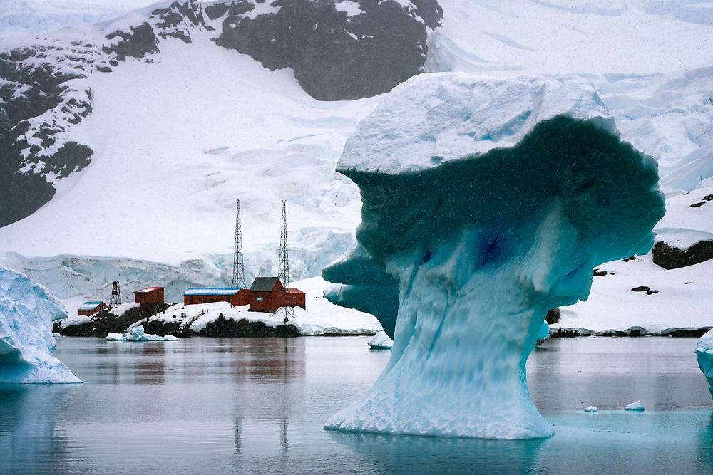 Mushroom like iceberg passing by Argentinian Brown Station in Antarctica.