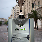 Broken sign of Agrotiki bank in Panepistimiou street during the the protests in Athens against the  unpopular austerity measures, June 29, 2011