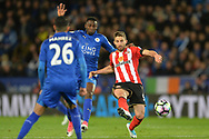 Fabio Borini of Sunderland ® and Wilfred Ndidi of Leicester city battle for the ball . Premier league match, Leicester City v Sunderland at the King Power Stadium in Leicester, Leicestershire on Tuesday 4th April 2017.<br /> pic by Bradley Collyer, Andrew Orchard sports photography.