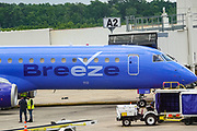A Breeze Airways Embraer ERJ-195AR commercial airliner parked at gate A2 at Charleston International Airport May 28, 2021 in North Charleston, South Carolina. The new discount airline fly the inaugural flight on May 27th.