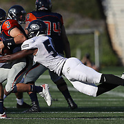 Fullerton College defensive lineman Tyler Stepney (58) sacks Orange Coast College quarterback Kody Whitaker (3) during the Southern California Football Association regular season game between the Fullerton College Hornets and the Orange Coast College Pirates at Lebard Stadium on the Orange Coast College campus on November 5, 2016.<br /> <br /> Photo by Darren Yamashita / Sports Shooter Academy