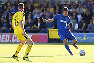 AFC Wimbledon defender Ben Purrington (3) passing the ball during the EFL Sky Bet League 1 match between AFC Wimbledon and Oxford United at the Cherry Red Records Stadium, Kingston, England on 29 September 2018.
