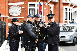 © Licensed to London News Pictures. 05/04/2019. London, UK. Armed police at the scene outside the Ecuador Embassy in London where the Wikileaks founder Julian Assange has been living since 2012. It has be reported that Assange is due to be thrown out of the embassy. Swedish authorities recently dropped their investigation into rape allegations against Assange. Photo credit: Ben Cawthra/LNP