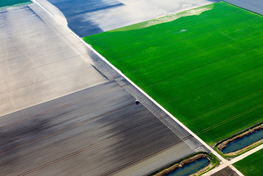 Nederland, Flevoland, Zeewolde, 01-05-2013; Gedeeltelijk beregende akkers, voren en gewas. Biddingringweg, zuidwestelijk van Biddinghuizen.<br /> Tractors pulling furrows in the vast fields.<br /> luchtfoto (toeslag op standard tarieven);<br /> aerial photo (additional fee required);<br /> copyright foto/photo Siebe Swart