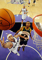 Sacramento Kings Mike Bibby drives past Seattle SuperSonics Rashard Lewis in the first half of game three of round one of the Western Conference Playoffs at Arco Arena.