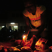 Woman selling meat in a night market at São Tomé city's downtown.