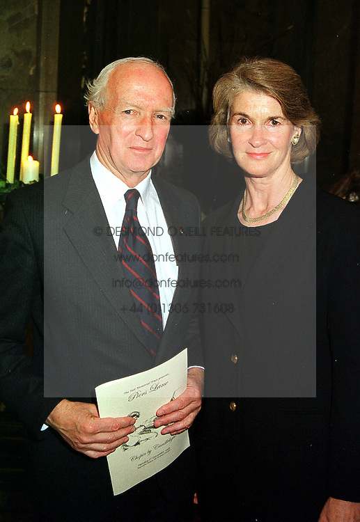 The Australian High Commissioner MR PHILIP FLOOD and MRS FLOOD, at a concert in London on 7th December 1999.MZU 21