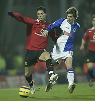 Photo: Aidan Ellis.<br /> Blackburn v Manchester United. Barclays Premiership. 01/02/2006.<br /> Blackburn's Morten Gamst Pedersen challenges United's  Cristiano Ronaldo