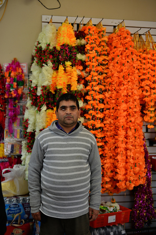 Employee at Nemaste Nepali-Indian Market.