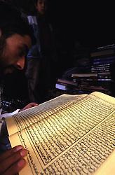 KABUL, an Afghan reading a book on Islam at a local bookshop in Jada.