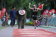 PHUKET, THAILAND - NOVEMBER 30:   Ruedi Wild of Switzerland celebrates winning the Challenge Half Laguna on November 30, 2014 in Phuket, Thailand.  (Photo by Matt Roberts/Getty Images)