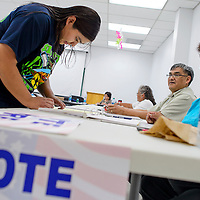 090914       Cable Hoover<br /> <br /> Nicole Etsate checks in at the voting station in the Zuni Tribal Complex in Zuni Tuesday.