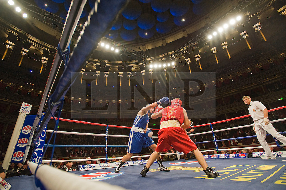 © Licensed to London News Pictures. London, UK  07/10/2011. CHRIS SMITH, RAFJ (Left) Vs OSEPH CANALE, US Marine Corp (right). Members of the UK and US Armed Forces go head to head in the Royal Albert Hall cup boxing match. This is the first time a boxing event has taken place in the historic venue following a court ruling banning the use of the hall for boxing and wrestling in 1999. The Court of Appeal subsequently overturned the decision earlier this year. The venue has hosted some of the greatest names in British boxing including Sir Henry Cooper, Frank Bruno, Lennox Lewis and Prince Naseem Hamed. Photo credit: Ben Cawthra/LNP