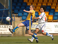 Photo: Leigh Quinnell.<br /> Mansfield Town v Carlisle United. Coca Cola League 2. 22/04/2006. Mansfields Jon Olav Hjelde gets to the ball before Carlises  Karl Hawley.