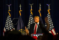 Donald J. Trump speaks to the crowd at Laconia Middle School.  Karen Bobotas for the Laconia Daily Sun